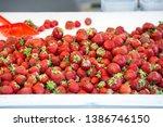 strawberries in fruit counter...   Shutterstock . vector #1386746150