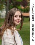 beautiful young woman posing... | Shutterstock . vector #1386799430