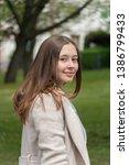 beautiful young woman posing... | Shutterstock . vector #1386799433