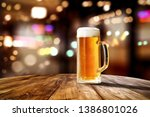 beer in glass and free space... | Shutterstock . vector #1386801026