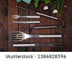 barbecue tools on wooden table. ... | Shutterstock . vector #1386828596