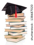 grad hat with books isolated on ... | Shutterstock . vector #138687020