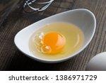 Eggs Yolk In White Dish On...