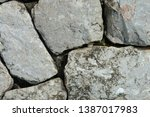 antique old cracked stone wall... | Shutterstock . vector #1387017983