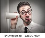 curious businessman with glass...   Shutterstock . vector #138707504