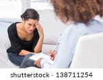 woman crying on sofa during