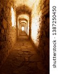 old stony passage in ancient... | Shutterstock . vector #1387250450