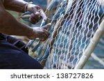 A Fisherman Fixes His Fishing...