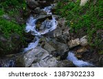 beautiful waterfall with clear... | Shutterstock . vector #1387302233