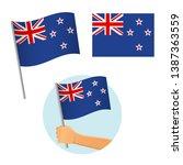 new zealand flag in hand.... | Shutterstock .eps vector #1387363559