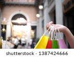 asian girls holding sale... | Shutterstock . vector #1387424666