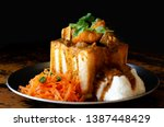 Stock photo a durban bunny chow or a quarter mutton bunny served with sambals this is an iconic durban 1387448429