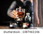bartender serve whiskey  on... | Shutterstock . vector #1387461146