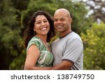 a happy mixed race couple relax ... | Shutterstock . vector #138749750