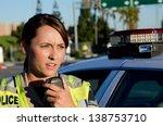 a female police officer... | Shutterstock . vector #138753710