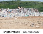municipal garbage dump at... | Shutterstock . vector #1387583039