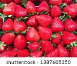 red sweet strawberry background.... | Shutterstock . vector #1387605350