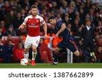 shkodran mustafi of arsenal and ... | Shutterstock . vector #1387662899