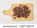 chopped chocolate on a cutting...   Shutterstock . vector #1387758470