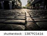 black cobbled stone road...   Shutterstock . vector #1387921616