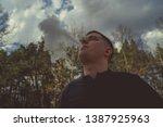 overweight man smoking near... | Shutterstock . vector #1387925963
