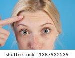 first wrinkles. woman wondering ... | Shutterstock . vector #1387932539