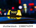 taxi and blurred city lights at ... | Shutterstock . vector #1388076599