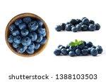 blueberries in a wooden bowl.... | Shutterstock . vector #1388103503