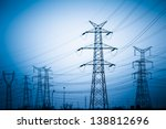 high voltage towers with sky...