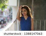 beautiful and young indian... | Shutterstock . vector #1388147063