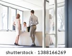 business people looking at...   Shutterstock . vector #1388166269