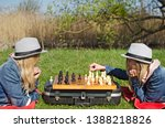 two sisters playing in chess | Shutterstock . vector #1388218826