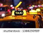 yellow taxi cab and blurred... | Shutterstock . vector #1388250989