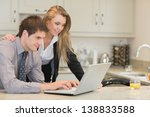 couple looking at the laptop in ... | Shutterstock . vector #138833588
