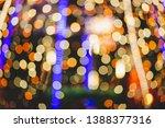 abstract light bulb bokeh... | Shutterstock . vector #1388377316