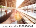 traveler holding compass to...   Shutterstock . vector #1388390669