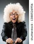young man wearing afro wig | Shutterstock . vector #1388526956