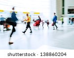 walking crowd in the airport hall - stock photo