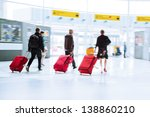 traveling people with trolley bags at the airport - stock photo