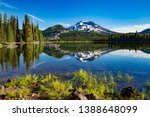 a cold morning on sparks lake with the south sister mountain in the background, near Bend, Oregon - stock photo
