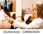 Little Blonde Girl Painting...