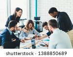 successful group of male and... | Shutterstock . vector #1388850689
