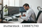 Stock photo lucky day happy young businessman or trader in formalwear and eyeglasses using laptop and smiling 1388871743