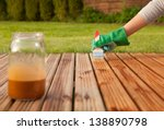 painting wooden patio deck with ... | Shutterstock . vector #138890798