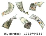 Small photo of Set of flying 100 dollars banknotes, isolated on white background