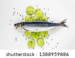 Stock photo fresh herring fish with lemons and peppers on white background above view 1388959886