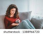 unhealthy sick woman suffers... | Shutterstock . vector #1388966720