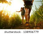 two young ladies walking with... | Shutterstock . vector #138906779
