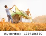 father and son install tent for ... | Shutterstock . vector #1389106580