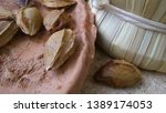 apricot grains on a clay plate. | Shutterstock . vector #1389174053